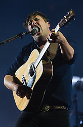 © Licensed to London News Pictures. 28/08/2015. Reading Festival, UK.  Mumford and Sons performing at Reading Festival 2015 28 August 2015 Day 1.  In this picture - Marcus Mumford.  Photo credit: Richard Isaac/LNP