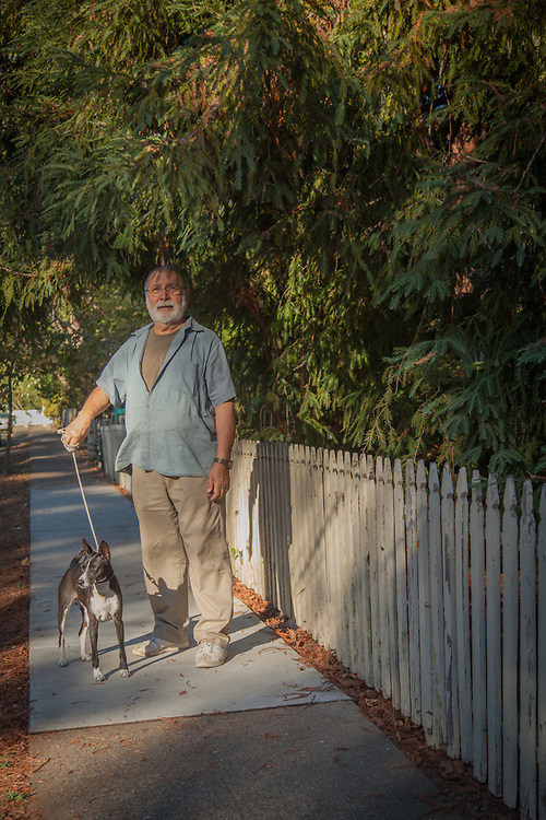 Gallery owner Carlo Marchiori on a walk around the block with his dog, Togo, Calistoga