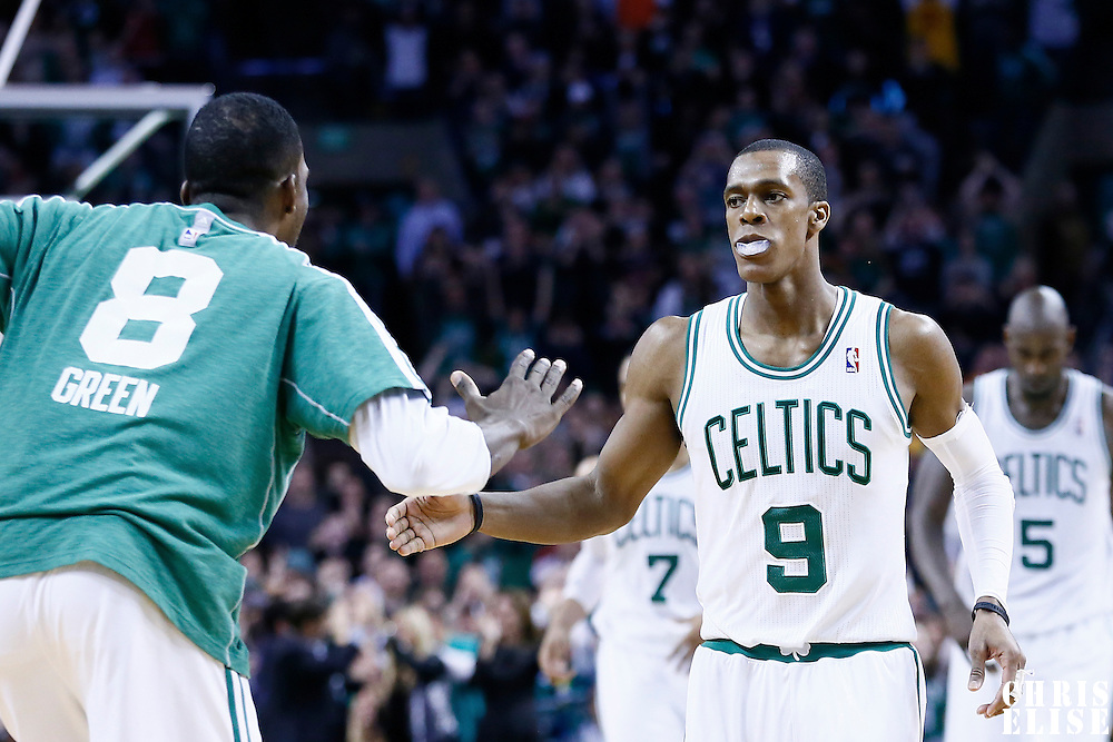 18 January 2013: Boston Celtics point guard Rajon Rondo (9) is congratulated by Boston Celtics power forward Jeff Green (8) during the Chicago Bulls 100-99 overtime victory over the Boston Celtics at the TD Garden, Boston, Massachusetts, USA.