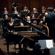 """January 18, 2012 - Manhattan, NY : The pianist Lang Lang, foreground at piano, and the New York Philharmonic, lead by Alan Gilbert (on podium) perform Bartók's """"Piano Concerto No. 2, BB 101 (1930-31)"""" at Lincoln Center's Avery Fisher Hall on Wednesday evening. CREDIT : Karsten Moran for The New York Times"""
