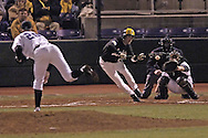 Wichita State's Josh Workman (left center) tries to lay down a bunt against Kansas State pitcher Brad Hutt (20) in the top of the fifth inning.  K-State defeated the 19th ranked Shockers 6-3 at Tointon Stadium in Manhattan, Kansas, March 14, 2006.