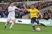 Oxford United midfielder Kemar Roofe and Swansea City defender Liam Shephard during the The FA Cup third round match between Oxford United and Swansea City at the Kassam Stadium, Oxford, England on 10 January 2016. Photo by Jemma Phillips.