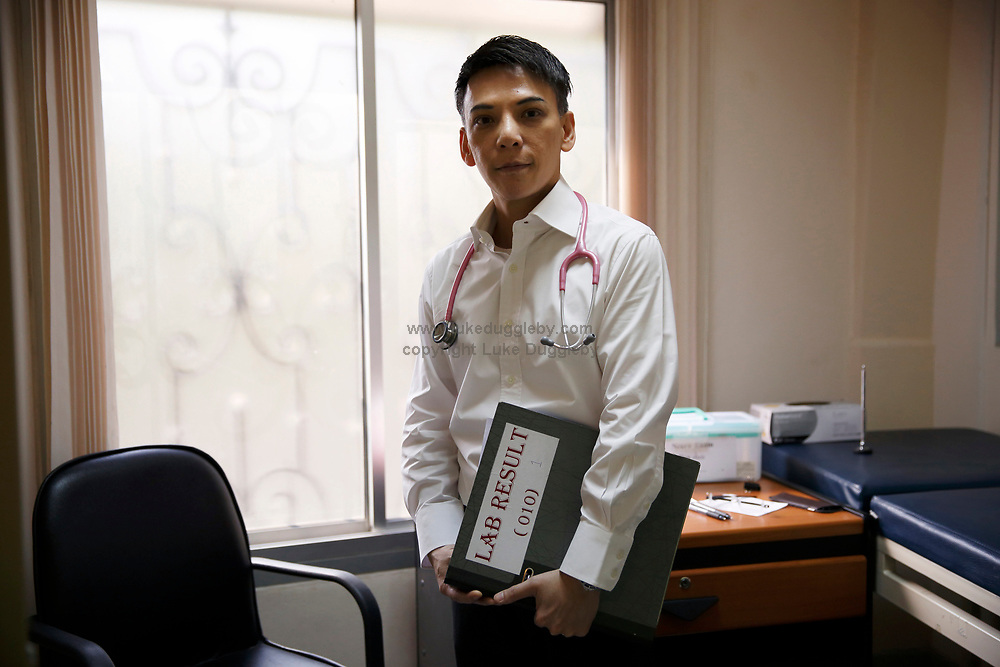 Dr. Thep Chalermchai, PhD, 46 years old, and a Research Trail Physician who specialises in Internal Medicine in his examination room. He has worked  at the Thai Red Cross AIDS Research Centre in Bangkok for 13 years. <br /> <br /> HIV researchers are launching a landmark study in Bangkok that will provide the best evidence to date about whether HIV patients, like those with cancer, can achieve long-term remission from the disease without treatment.