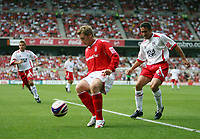 Photo: Rich Eaton. <br /> <br /> Nottingham Forest v AFC Bournemouth. Coca Cola Championship. 11/08/2007. Forest's Kris Commons (l) gets to the ball of ahead of Bournemouth's Paul Telfer (r).