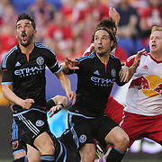 David Villa, (left), Ned Grabavoy, (center), NYCFC and Dax McCarty, New York Red Bulls, challenge for the ball  during the New York Red Bulls Vs NYCFC, MLS regular season match at Red Bull Arena, Harrison, New Jersey. USA. 10th May 2015. Photo Tim Clayton