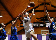 Amherst College's Jackie Nagle (32) goes up for a basket during a game against Hamilton College, Friday, Jan. 9, 2015, in Amherst, Mass.  Amherst has broken UConn's women's NCAA record with 104 consecutive home victories and is closing in on the Kentucky men's record of 120-plus wins set decades ago. (Jessica Hill for the New York Times)            NYTCREDIT: Jessica Hill for The New York Times