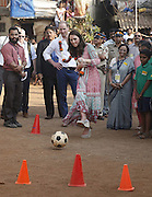 April 10, 2016 - Mumbai, INDIA - <br /> <br /> Britain's Prince William, watches as his wife Kate, the Duchess of Cambridge, plays soccer during their visit to a slum in Mumbai, India, Sunday, April 10, 2016. The royal couple began their weeklong visit to India and Bhutan, by laying a wreath at a memorial Sunday at Mumbai iconic Taj Mahal Palace hotel, where 31 victims of the 2008 Mumbai terrorist attacks were killed.<br /> ©Exclusivepix Media