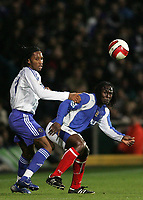 Photo: Lee Earle.<br /> Portsmouth v Chelsea. The Barclays Premiership. 03/03/2007.Chelsea's Didier Drogba (L) and Portsmouth's Linvoy Primus watch the ball.
