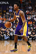 Dec 23, 2013; Phoenix, AZ, USA; Los Angeles Lakers forward Nick Young (0) handles the ball against the Phoenix Suns at US Airways Center. The Suns won 117-90. Mandatory Credit: Jennifer Stewart-USA TODAY Sports