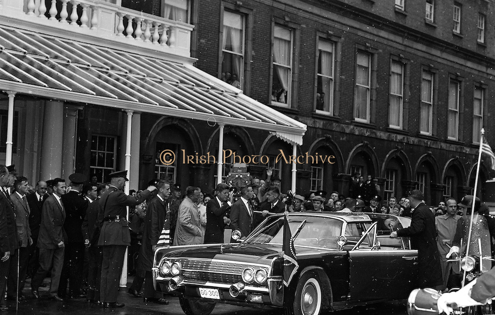 Dr. A. J McConnell at Trinity College hands a Dublin Honorary degree to President Kennedy during the St. Patricks Hall, Dublin castle ceremony. (28/6/63) ..President Kennedy receives an Honorary Degree of the National University of Ireland and Freedom of the City at Dublin Castle.  *** Local Caption *** It is important to note that under the COPYRIGHT AND RELATED RIGHTS ACT 2000 the copyright of these photographs are the property of the photographer and they cannot be copied, scanned, reproduced or electronically stored in any form whatsoever without the written permission of the photographer