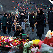 KIEV, UKRAINE - February 23, 2014: Thousands lay flowers and candles in memory of the anti-government protestors killed during violent clashes with Ukrainian special forces, in Kiev's Independence Square. CREDIT: Paulo Nunes dos Santos