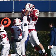 Smyrna defensive back Jacob Soroko (21) celebrates with teammate Jeremy D'Aguiar (23) after an interception during the DIAA division one Football Championship game between Top-seeded Middletown (11-0) and second-seeded Smyrna (11-0) Saturday, Dec. 03, 2016 at Delaware Stadium in Newark.