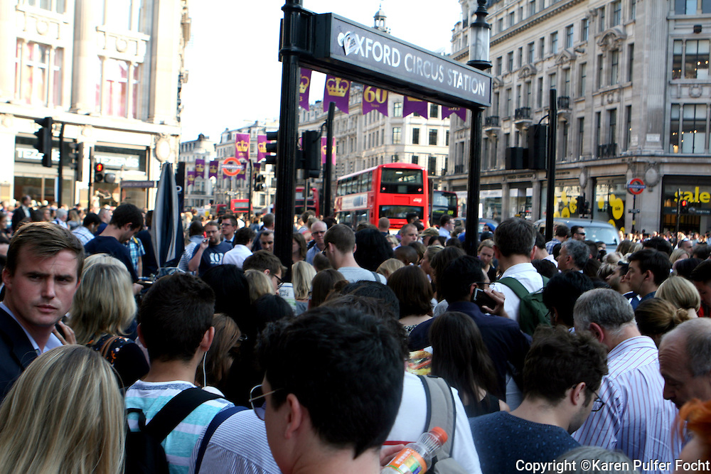 Citizens and visitors to England have been awaiting the delivery of the royal baby. The subway over flows during rush hour at Oxford Circus Station in London, England recently. London has experienced record breaking sunny and dry weather this summer, which has been nice for tourists.