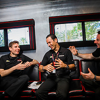 ST. PETERSBURG, FL - March 29, 2015 -- IndyCar drivers Will Power, left to right, Helio Castroneves, and Simon Pagenaud share a laugh during the St. Pete Grand Prix in downtown St. Petersburg, Florida. (PHOTO / CHIP LITHERLAND)