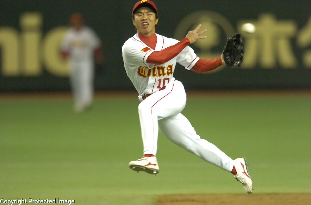 Team China second baseman Guangbiao Liu makes a putout at first base in the 2nd inning against Team Chinese Taipei in Game 5 of the World Baseball Classic at Tokyo dome, Tokyo, Japan.
