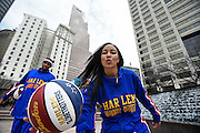 "The Harlem Globetrotters' Tammy ""T-Time"" Brawner, the team's 10th female player in its existence, leads them from Woodruff Park during a 2.7-mile Atlanta Streetcar downtown tour and basketball handling skills demonstration in advance of a pair of the team's upcoming shows at the Arena at Gwinnett, on Monday, March 9, 2015, in Atlanta. David Tulis / AJC Special"