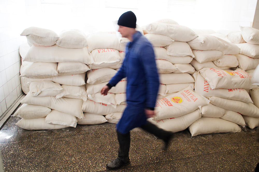A mine worker passes stacks of flour and sugar sacks at Zasyadtko Mine on March 7, 2015 in Donetsk, Ukraine.