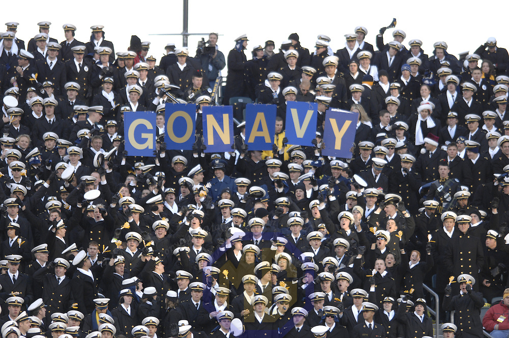 02 December 2006:  Navy midshipmen cheer their team in action against Army on December 2, 2006.  The Navy Midshipmen defeated the Black Knights of Army 26-14 at Lincoln Financial Field in Philadelphia, Pennsylvania.