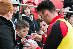 Kieffer Moore of Rotherham United signs a match ball for a young fan - Mandatory by-line: Ryan Crockett/JMP - 28/10/2017 - FOOTBALL - Aesseal New York Stadium - Rotherham, England - Rotherham United v Gillingham - Sky Bet League One