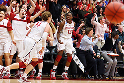 March 21, 2011; Stanford, CA, USA; Stanford Cardinal forward Kayla Pedersen (14) is cheered on by teammates after scoring a three point basket against the St. John's Red Storm during the second half of the second round of the 2011 NCAA women's basketball tournament at Maples Pavilion. Stanford defeated St. John's 75-49.