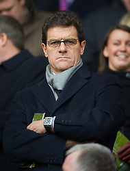 LIVERPOOL, ENGLAND - Saturday, March 8, 2008: England manager Fabio Capello watches Liverpool take on Newcastle United during the Premiership match at Anfield. (Photo by David Rawcliffe/Propaganda)