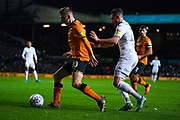 Leeds United midfielder Jack Harrison (22) and Hull City forward Jarrod Bowen (20) during the EFL Sky Bet Championship match between Leeds United and Hull City at Elland Road, Leeds, England on 10 December 2019.