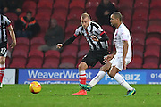 Grimsby Town midfielder Luke Summerfield (19)  and Curtis Weston Barnet FC midfielder (8) during the EFL Sky Bet League 2 match between Grimsby Town FC and Barnet at Blundell Park, Grimsby, United Kingdom on 12 November 2016. Photo by Ian Lyall.