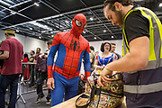 "UNITED KINGDOM, London: 28 May 2017 ""Spiderman"" gets his bag searched at the entrance to the MCM London Comic Con. <br /> The comic convention, which will be visited by tens of thousands of comic book and cosplay fans, is being held at London's ExCel this weekend. Rick Findler / Story Picture Agency"