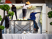 "04 NOVEMBER 2018 - BANGKOK, THAILAND: Workers put the decorations for the funeral of Vichai Srivaddhanaprabha at Wat Debsirin on the second day of funeral rites for Vichai. The ""Possible Man"" reflects Vichai's legacy in Leicester because he was viewed as the man who made everything possible after Leicester won the 2015-16 Premier League Championship. Vichai was the owner of King Power, a Thai duty free conglomerate, and the Leicester City Club, a British Premier League football (soccer) team. He died in a helicopter crash at the King Power stadium in Leicester after a match on October 27. Vichai was Thailand's 5th richest man. The funeral is expected to last one week.  PHOTO BY JACK KURTZ"