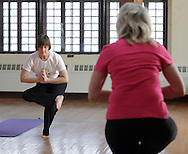 Middletown, New York - Instructor Maria Blon, at left, of Create Your Wellness leads a yoga class at the First Presbyterian Church on April 21, 2011.