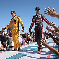 Kyle Busch (L) and brother Kurt Busch are seen during driver introductions for the 60th Annual NASCAR Daytona 500 auto race at Daytona International Speedway on Sunday, February 18, 2018 in Daytona Beach, Florida.  (Alex Menendez via AP)