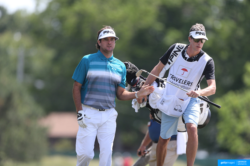 Bubba Watson, USA and his caddie Ted Scott during the second round of the Travelers Championship at the TPC River Highlands, Cromwell, Connecticut, USA. 20th June 2014. Photo Tim Clayton
