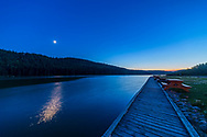 The waxing 6-day-old Moon east of Jupiter and in twilight at Reesor Lake, July 29, 2017, in the Cypress Hills, Alberta. This serives to demonstrate the angle between the waxing Moon and the sunset point. <br /> <br /> This is a single exposure with the 14mm Rokinon SP lens and Canon 6D.