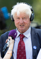 © Licensed to London News Pictures. 23/07/2019. London, UK. Stanley Johnson, father of newly elected Conservative Party leader and next Prime Minister Boris Johnson gives a radio interview outside the Queen Elizabeth II Conference Centre. Photo credit: Peter Macdiarmid/LNP