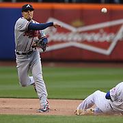 Jace Peterson, Atlanta Braves turns a double play as Lucas Duda slides into second during the New York Mets Vs Atlanta Braves MLB regular season baseball game at Citi Field, Queens, New York. USA. 23rd April 2015. Photo Tim Clayton