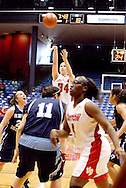 UD senior Justine Raterman (34) takes a shot in the first half as the Rhode Island Rams play the University of Dayton Flyers at UD Arena in Dayton, Saturday, January 7, 2012.