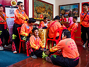 05 FEBRUARY 2019 - BANGKOK, THAILAND:  Members of a Lion Dance troupe massage each other while they wait to perform on Chinese New Year at Canton Shrine. Chinese New Year celebrations in Bangkok started on February 4, 2019, although the city's official celebration is February 5 - 6. The coming year will be the Year of the Pig in the Chinese zodiac. About 14% of Thais are of Chinese ancestry and Lunar New Year, also called Chinese New Year or Tet is widely celebrated in Chinese communities in Thailand.       PHOTO BY JACK KURTZ
