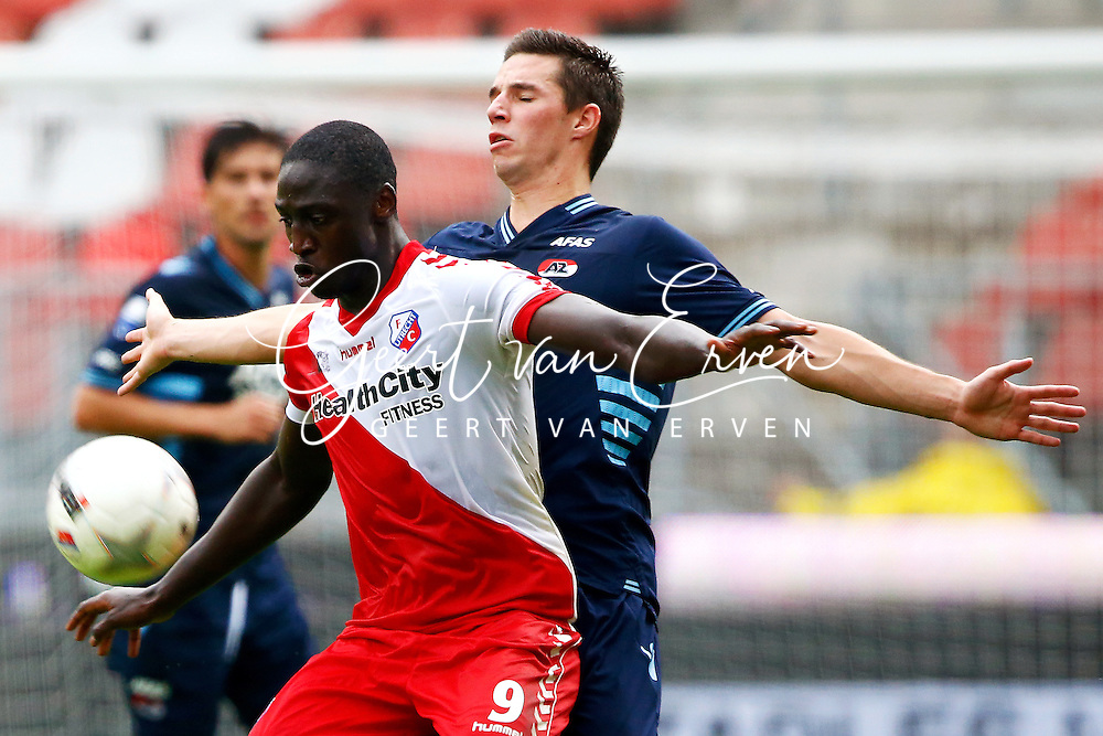 Onderwerp/Subject: FC Utrecht - AZ Alkmaar - Eredivisie<br /> Reklame:  <br /> Club/Team/Country: <br /> Seizoen/Season: 2013/2014<br /> FOTO/PHOTO: Jacob MULENGA (L) of FC Utrecht in duel with Nick VIERGEVER (R) of AZ Alkmaar. (Photo by PICS UNITED)<br /> <br /> Trefwoorden/Keywords: <br /> #04 $94 &plusmn;1371811811150<br /> Photo- &amp; Copyrights &copy; PICS UNITED <br /> P.O. Box 7164 - 5605 BE  EINDHOVEN (THE NETHERLANDS) <br /> Phone +31 (0)40 296 28 00 <br /> Fax +31 (0) 40 248 47 43 <br /> http://www.pics-united.com <br /> e-mail : sales@pics-united.com (If you would like to raise any issues regarding any aspects of products / service of PICS UNITED) or <br /> e-mail : sales@pics-united.com   <br /> <br /> ATTENTIE: <br /> Publicatie ook bij aanbieding door derden is slechts toegestaan na verkregen toestemming van Pics United. <br /> VOLLEDIGE NAAMSVERMELDING IS VERPLICHT! (&copy; PICS UNITED/Naam Fotograaf, zie veld 4 van de bestandsinfo 'credits') <br /> ATTENTION:  <br /> &copy; Pics United. Reproduction/publication of this photo by any parties is only permitted after authorisation is sought and obtained from  PICS UNITED- THE NETHERLANDS