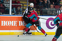 KELOWNA, CANADA - MARCH 16:  Dallas Hines #2 of the Vancouver Giants is checked by Kaedan Korczak #6 of the Kelowna Rockets during first period on March 16, 2019 at Prospera Place in Kelowna, British Columbia, Canada.  (Photo by Marissa Baecker/Shoot the Breeze)