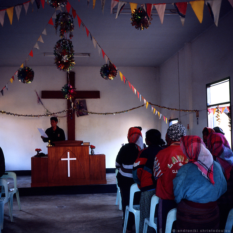 Sunday morning church service at Akha village Huei Naam Kun that is located in the mountains near Chiang Rai. The village has become Christian during the last 10 years. Before that it followed the traditional animism Acha religion.