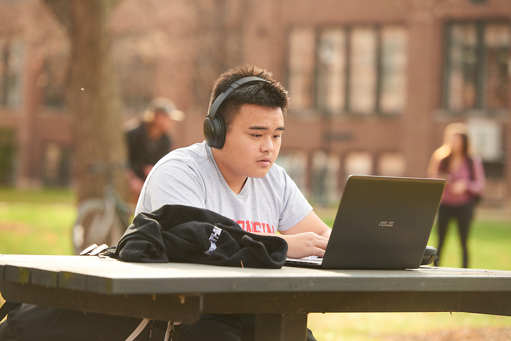 People; Student Students; Type of Photography; Candid; UWL UW-L UW-La Crosse University of Wisconsin-La Crosse; Objects; Computer; Fall; November; Location; Outside; Activity; Studying; Diversity