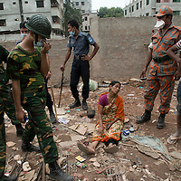 Rana Plaza 8 Storey Building collapsed in  around 8.45 morning on 24 April 2013 in Savar outskirt of Dhaka,Bangladesh. <br /> <br /> The building had 5 Garments, 1 bank and many shops. <br /> <br /> At least 350 killed and thousand inured
