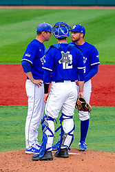 NORMAL, IL - May 01: Meeting on the mound with coach, catcher CJ Huntley and pitcher Triston Polley during a college baseball game between the ISU Redbirds and the Indiana State Sycamores on May 01 2019 at Duffy Bass Field in Normal, IL. (Photo by Alan Look)