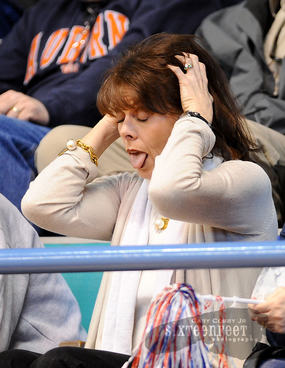 Photo by Gary Cosby Jr.   Charlotte Allen, wife to Brewer coach Ricky Allen, shows the stress of being a fan as the Brewer Lady Patriots played Russellville in the NW Region tournament in Hanceville.