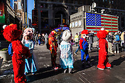 A group of children's costume characters, including Elmo from Sesame Street and Elsa from Frozen, stand waiting to interact with tourists in Times Square, Midtown Manhattan, New York City, New York, United States.  In 2016, Mayor de Blasio signed a law to declare pedestrian plazas, like Times Square to be no-soliciting zones due to the ongoing issues of costume characters harassing tourists for money.  (photo by Andrew Aitchison / In pictures via Getty Images)