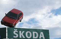 CZECH REPUBLIC BOHEMIA PRAGUE JUL97 - A Skoda Felicia car hangs mounted on top of a billboard.   . . jre/Photo by Jiri Rezac. . © Jiri Rezac 1997. . Tel:   +44 (0) 7050 110 417. Email: jiri@jirirezac.com. Web:   www.jirirezac.com