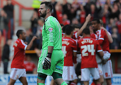 Sheffield United's Mark Howard cuts a dejected figure as Swindon Town's Ben Gladwin celebrates with his team mates - Photo mandatory by-line: Dougie Allward/JMP - Mobile: 07966 386802 - 11/05/2015 - SPORT - Football - Swindon - County Ground - Swindon Town v Sheffield United - Sky Bet League One - Play-Off