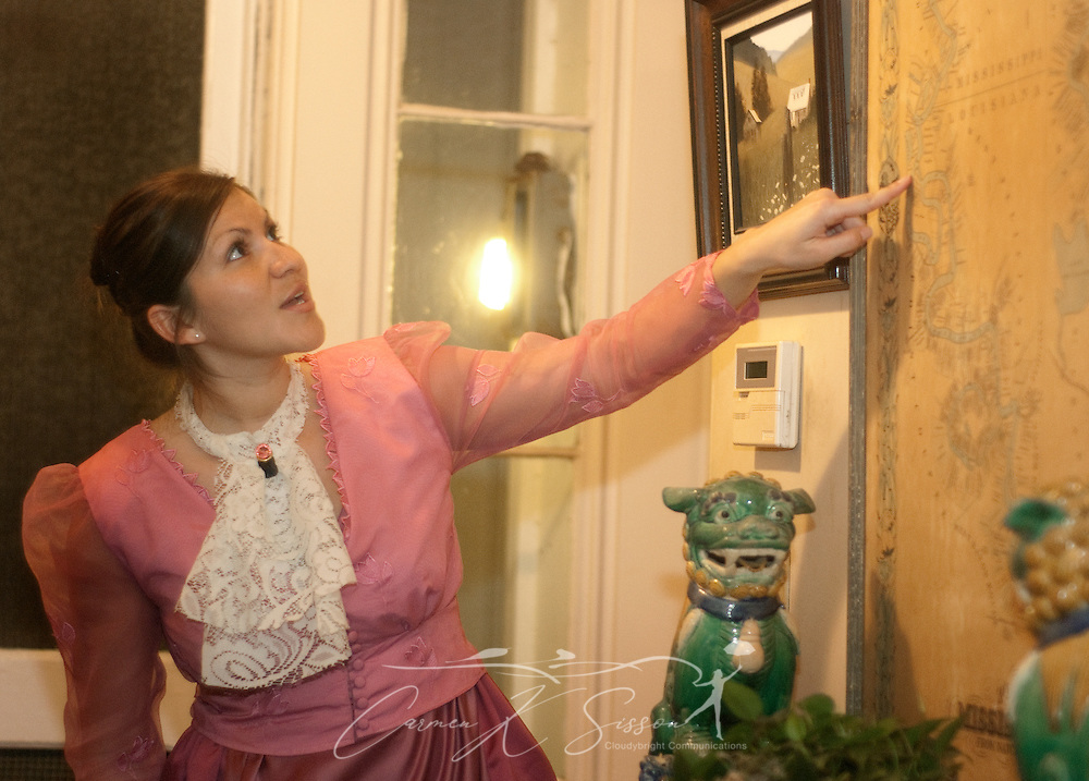 Tour guide Jessica Soto discusses an antique map at Riverview, a historic home in Columbus, Miss., April 17, 2010. The 1850 Greek Revival home was among nearly two dozen sites on tour during Columbus' annual Spring Pilgrimage. (Photo by Carmen K. Sisson/Cloudybright)