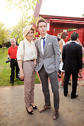 EDDIE REDMAYNE and Carice van Houten at the annual Serpentine Gallery Summer party this year sponsored by Jaguar held at the Serpentine Gallery, Kensington Gardens, London on 8th July 2010.  2010 marks the 40th anniversary of the Serpentine Gallery and the 10th Pavilion.