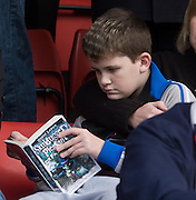 Half time reading for this young fan - Stirling Albion v Dundee, IRN BRU Scottish League 1st Division, Forthbank Stadium, Stirling<br /> <br />  - © David Young<br /> ---<br /> email: david@davidyoungphoto.co.uk<br /> http://www.davidyoungphoto.co.uk